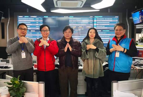 春节期间坚守岗位的中新社通稿中心团队