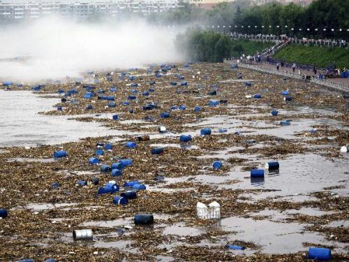About 7,000 chemical barrels have been swept into a major river in northeast China's Jilin Province.