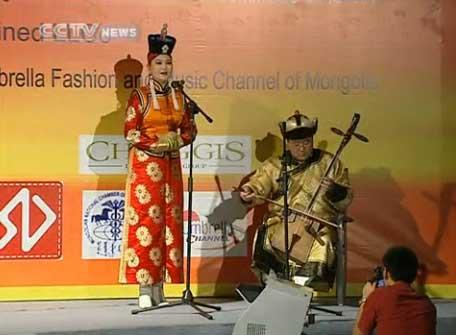 A fashion show is celebrating the traditional dress of Mongolians at the Shanghai University.