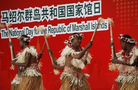 Artists from the Republic of Marshall Islands perform during a ceremony celebrating the National Pavilion Day of the Republic of Marshall Islands at the 2010 World Expo in Shanghai, east China, Aug. 17, 2010. (Xinhua