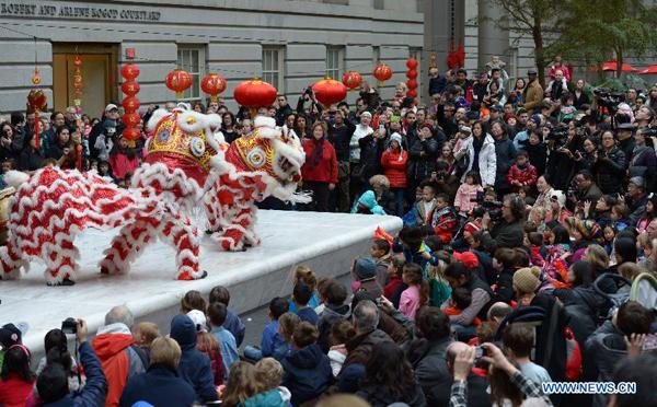 people watch lion dancing during an event celebrating the upcoming chinese lunar new year at smithsonian american art museum washington dc - Chinese New Year Dc