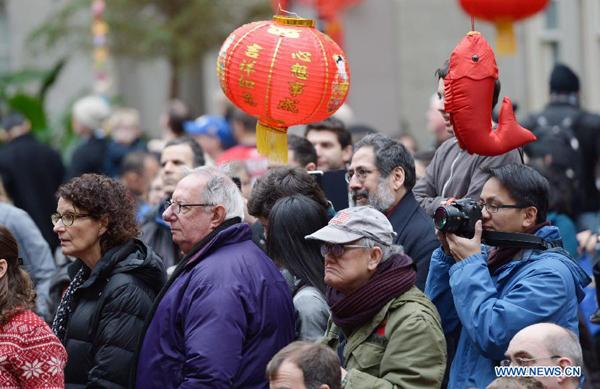 people watch performance by chinese artists during an event celebrating the upcoming chinese lunar new year at smithsonian american art museum - Chinese New Year Dc
