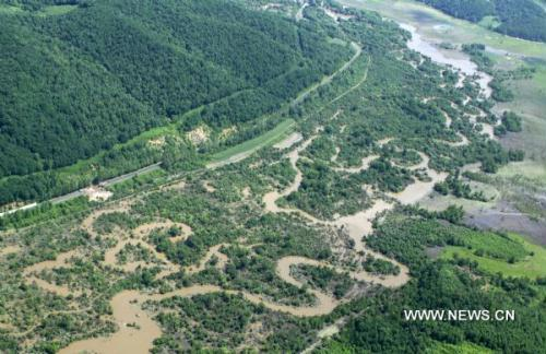 The aerial photo taken on July 30, 2010 shows the flood-battered area in Antu County of Yanbian Korean Autonomous Prefecture, northeast China's Jilin Province.(Xinhua/Jiang Hechun)