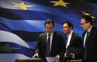 Greek Finance Minister George Papaconstantinou, center, take his seat prior to a press conference in Athens, on Tuesday, April 20, 2010. Finance Minister George Papaconstantinou said he would travel to the United States Friday to attend an IMF meeting, and would hold talks with U.S. Treasury Secretary Tim Geithner and IMF chief Dominique Strauss-Kahn. Greece has raised ?1.95 billion ($2.62 billion) in a 13-week treasury bill auction that was more than four times oversubscribed, the public debt management agency said Tuesday.(AP Photo/Nikolas Giakoumidis)