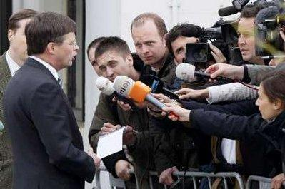 Netherlands' Prime Minister Jan Peter Balkenende speaks to the press about the Tripoli air crash at Claus Party Centre in Hoofddorp May 13, 2010. Aviation experts combed debris for more clues on Thursday after finding the two black boxes from an Airbus jet that crashed at Libya's Tripoli airport, killing all but one of the 104 people on board. The sole survivor of Afriqiyah Airways Flight 8U771 was a 9-year-old Dutch boy returning from a safari holiday with his family in South Africa, a Dutch newspaper reported.REUTERS/Michael Kooren