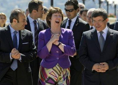 European Union High Representative for Foreign Affairs and Security Policy Catherine Ashton, center, chats with Turkey's Foreign Minister Ahmet Davutoglu, right, and Turkey's State Minister for EU Affairs Egemen Bagis after a Turkey-EU Ministerial Political Dialogue meeting in Istanbul, Turkey, Tuesday, July 13, 2010.