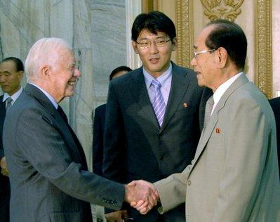 In this Wednesday, Aug. 25, 2010 photo, former U.S. President Jimmy Carter, left, shakes hands with North Korea's No. 2 Kim Yong Nam at Mansudae Assembly Hall in Pyongyang, North Korea. North Koreans welcomed Jimmy Carter back to Pyongyang with smiles, salutes and hearty handshakes Wednesday as the former American president arrived on a mission to bring home a Boston man jailed in the communist country since January.(AP Photo/Kyodo News)