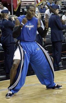 In this April 21, 2010 photo, Orlando Magic center Dwight Howard dances in front of teammates during a pre-game ritual prior to Game 2 in the first round of the NBA basketball playoffs against the Charlotte Bobcats, in Orlando, Fla. The Orlando Magic's choreographed warmup routine is a bit odd by NBA standards, and only one of the team's many playful antics.(AP Photo/John Raoux)