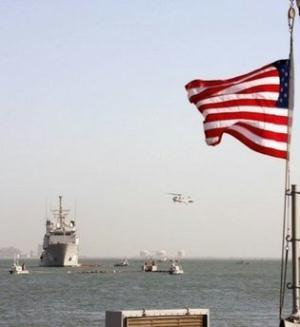 A US Navy Ocean Tug ship and a helicopter of the Bahrain-based Fifth Fleet participate in a crisis response exercise in a port in the capital Manama, in 2007. Parliament speaker Ali Larijani has slammed plans by the US to beef up defences in the Gulf against potential Iranian missile attacks, insisting the Islamic republic is no threat to its neighbours. (AFP/File/Adam Jan)