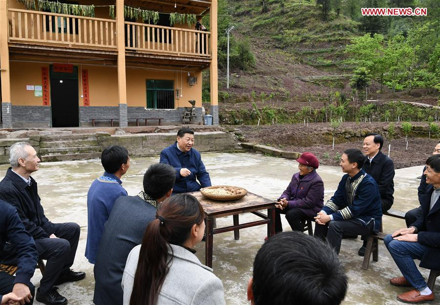 Chinese President Xi Jinping, also general secretary of the Communist Party of China Central Committee and chairman of the Central Military Commission, talks with villagers to learn about the progress of poverty alleviation and in solving prominent problems including meeting the basic need of food and clothing and guaranteeing compulsory education, basic medical care and safe housing, in Huaxi Village of Shizhu Tujia Autonomous County, southwest China