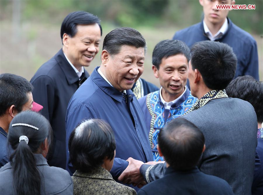 Chinese President Xi Jinping, also general secretary of the Communist Party of China Central Committee and chairman of the Central Military Commission, talks with villagers in Huaxi Village of Shizhu Tujia Autonomous County, southwest China