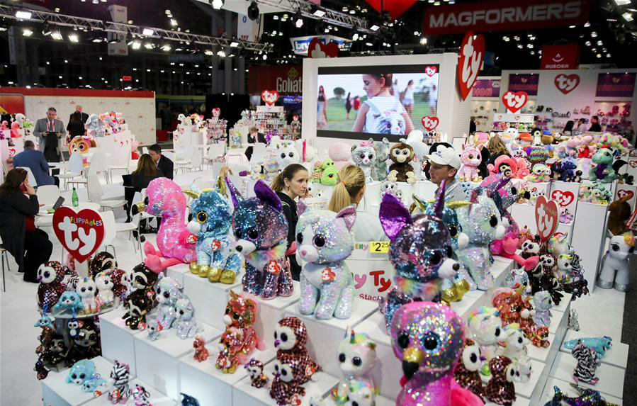 Visitors look at stuffed toys at the booth of Ty Inc. during the 116th Annual North American International Toy Fair at the Jacob K. Javits Convention Center in New York, the United States, on Feb. 19, 2019. (Xinhua/Wang Ying)