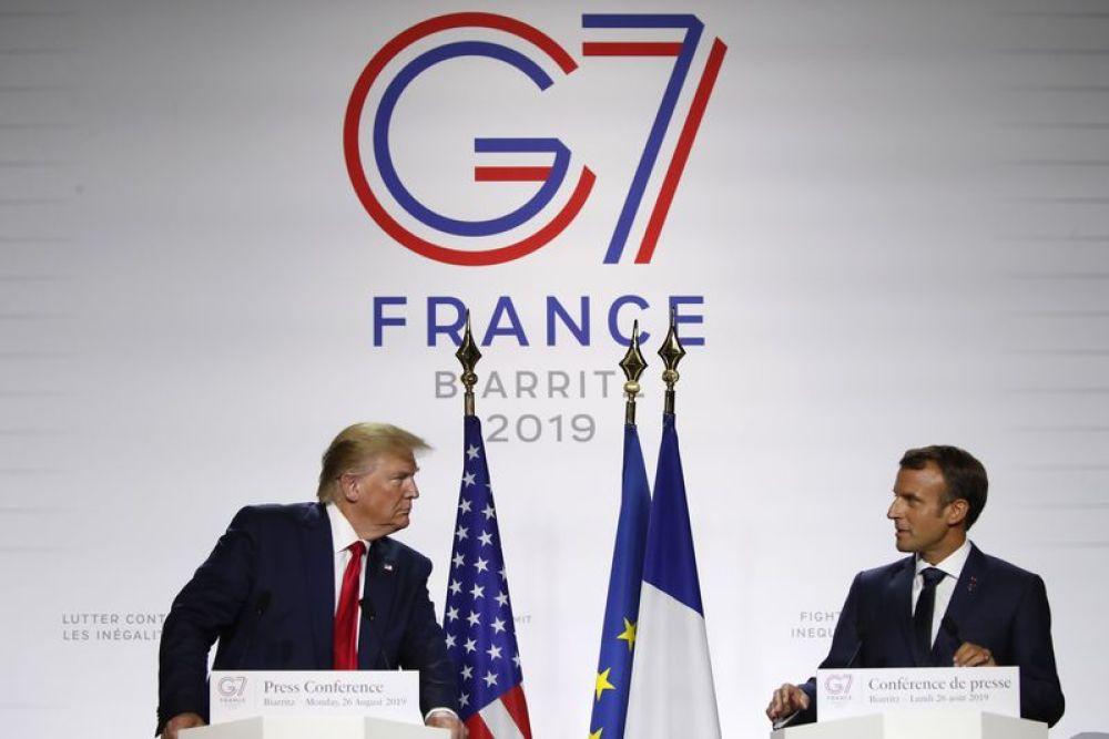 8月26日,在法国南部城市比亚里茨,美国总统特朗普和法国总统马克龙在七国集团峰会期间出席联合记者会。新华社/美联