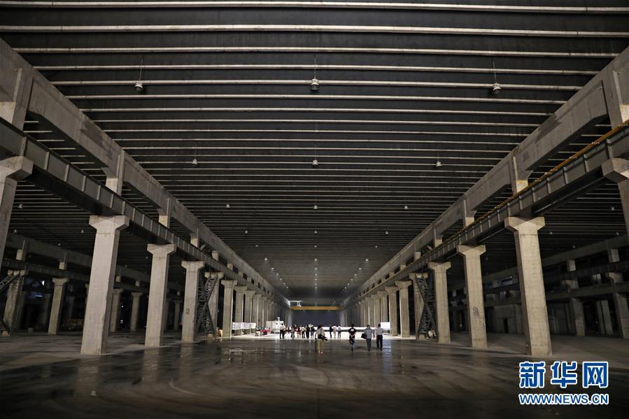 """大连光洋科技集团正在建设的""""地下工厂""""(2019年6月25日摄)  新华社记者 姚剑锋 摄"""