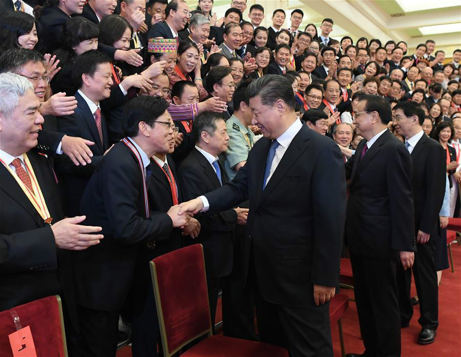 Chinese President Xi Jinping, also general secretary of the Communist Party of China (CPC) Central Committee and chairman of the Central Military Commission, meets with representatives of outstanding units and individuals in education circles at the Great Hall of the People in Beijing, capital of China, Sept. 10, 2019, extending Teachers