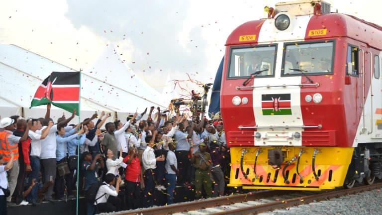 People throw confetti at the port city of Mombasa on May 30, 2017 after Kenyan President Uhuru Kenyatta inaugurated a cargo train before its first journey to Nairobi.